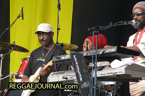 Edwin Byron, guitar and Christian Molina, drums, Midnite 2007-08-12 Reggae Sundance, E3 strand, Eersel, Holland